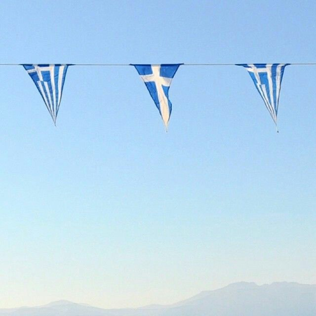 The blueness of the sea, the whiteness of the air and the brightness of the sun are all here, in these flags. Visit Greece.