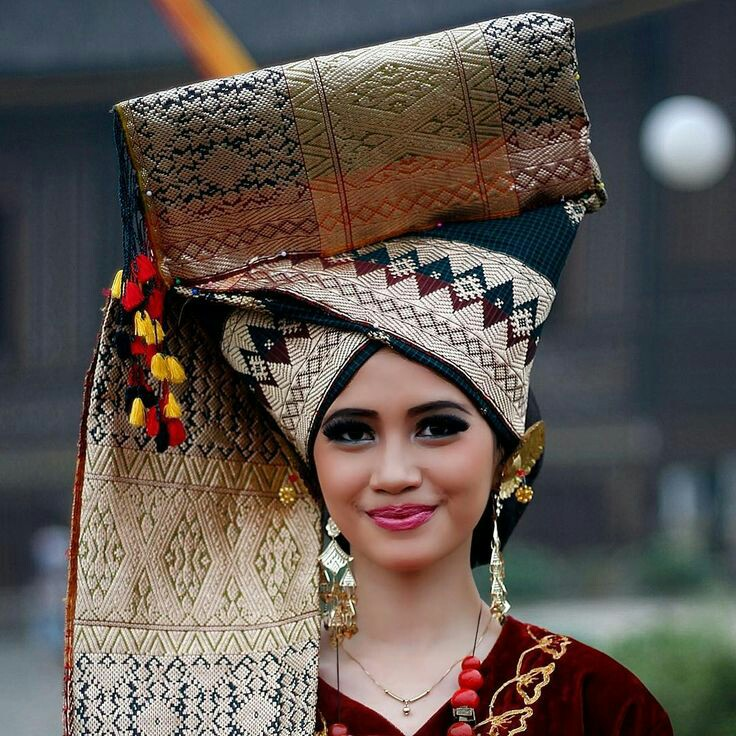 Beautiful Minang women wearing traditional costume (West Sumatra)
