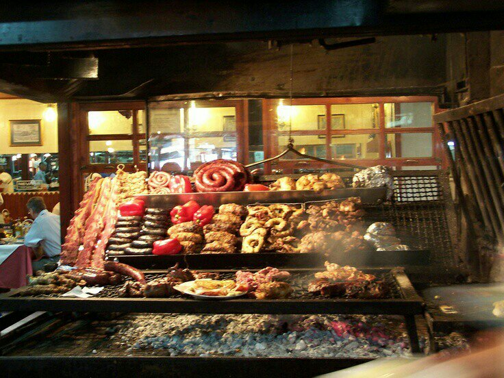 Mercado del Puerto, Montevideo, Uruguay. This is the place to go for lunch. BBQ all over.